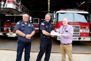 (Left to Right) Fire Chief Clayton Simonson, Jr., Fire Inspector Craig Ratz, Regional Director of Stores Brian Schroeder